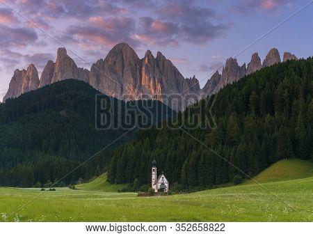Church At Santa Magdalena On The  Italian Mountains Dolomites Alps At Sunset