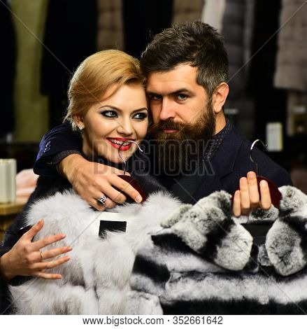 Elegance And Glamour Concept. Couple In Love Tries Sable Overcoats