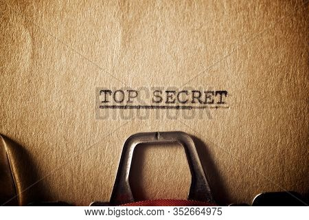 The sentence, Top Secret, written with a typewriter.