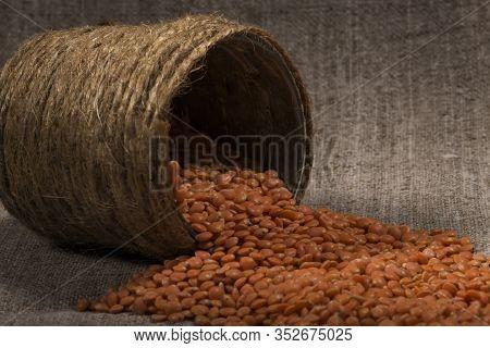 Red Lentils Poured Out, Scatter Of Cans Of Handmade. Lentil Texture, Lentil Pattern, Background, Mac