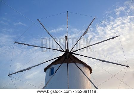 Old White Traditional Windmill At Sunset In Parikia On Paros Island, Cyclades, Greece