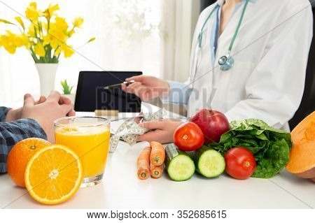 Vegetable Diet Nutrition And Medication Concept. Nutritionist Offers Healthy Vegetables Diet. In A N