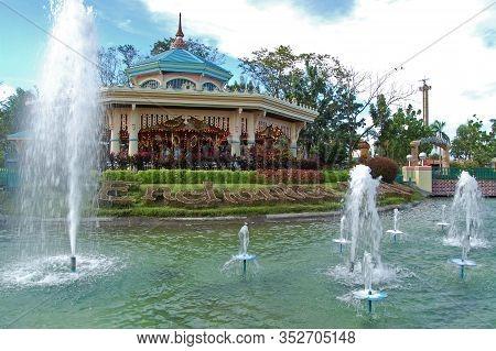 Laguna, Ph - Nov 7: Enchanted Kingdom Theme Park Carousel Facade At Daytime On November 7, 2009 In S