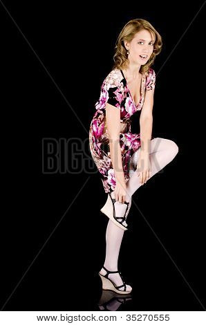 Sweet-faced Fashion Model In Colorful Spring Outfit Removing Her Shoe.