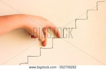 Girls Hand Imitating Walking Upstairs. Concept Of Career Growth. Goal Achievement, Leadership And Pr
