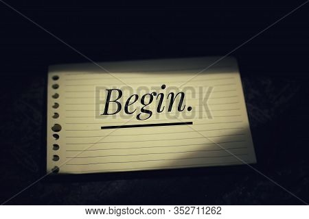 Inspirational Quote - Begin. With Black Background Of Single Word On White Paper Note Concept.  Life