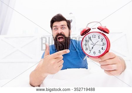 Unhappy Man Pointing At The Alarm Clock. Hate Noise Of Alarm Clock. Man Awake With Retro Alarm Clock