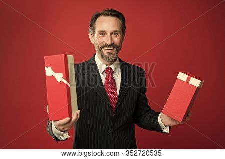 Boxing Day Sale. Happy Manager Prepare Gifts For Boxing Day. Mature Man Celebrate Boxing Day. Giving