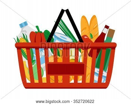 Red Plastic Shopping Basket Full Of Groceries Products. Shopping At The Supermarket. Grocery Store.