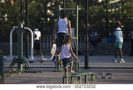 Bronx, New York/usa - August 10, 2019: Little Girl Plays In Outdoor Park Near Yankee Stadium.