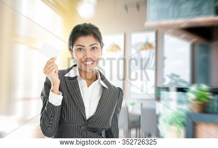 New business opportunity concept. Indian business woman hand holding a blank card.