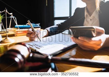 Business Woman Or Lawyers Discussing By Phone With Brass Scale On Wooden Desk In Office. Law, Legal
