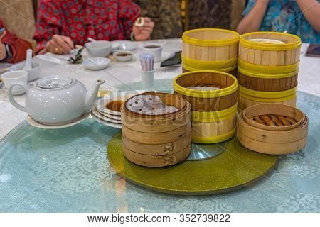 Pile Of Dimsum Steamer Bamboo Boxes In Hong Kong Restaurant