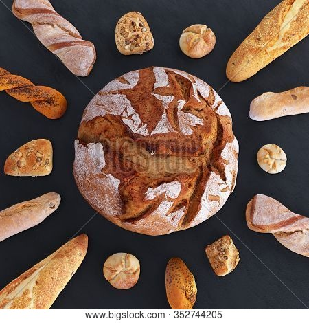 Different Types Of Bread And Rolls In The Top View. Bread In The Form Of Sun And Rays From Baguettes