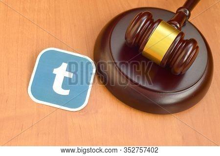 Tumblr Paper Logo Lies With Wooden Judge Gavel. Entertainment Lawsuit Concept