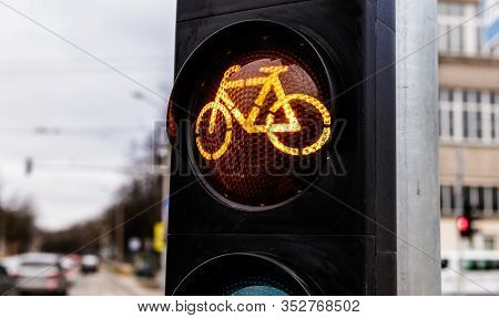 Traffic Light For Cyclists. Yellow Light For Bycicle Lane On A Traffic Light. Traffic Light In Yello