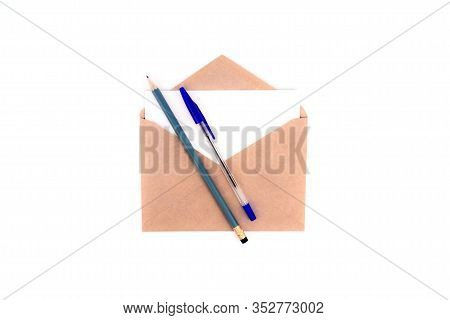Craft Envelope With Letter White Card, Pen And Pecil Flat Lay Isolated On White Background. Top View