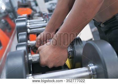 Close Up Of Man Hand With Dumbbell