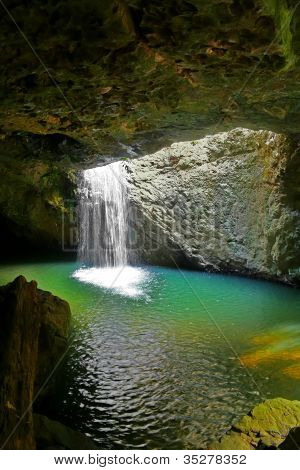 The waterfall at Natural Arch in Springbrook National Park in the Gold Coast hinterland in Queensland Australia. poster