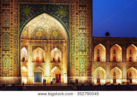 Registan Square in Samarkand. Madrasah at night with light