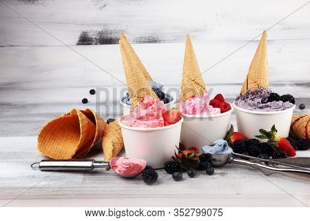 Various Of Ice Cream Flavors Blueberry, Strawberry, Blackberry Setup On Rustic Background . Summer A