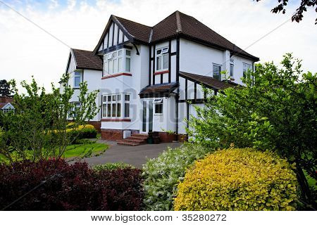 Typical 1930s white semi detatched house with Bay Window and pre
