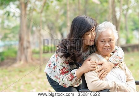 Help And Care Asian Senior Or Elderly Old Lady Woman Patient Sitting On Wheelchair At Nursing Hospit