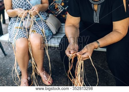 Two Females Weaving Baskets On The Craft Workshop. Hands Holding The Craftwork, Close Up Shot.