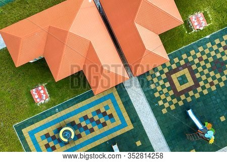Aerial View Of New Alcove In Kindergarten Play Yard With Red Tiled Roof For Outdoor Children Activit