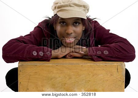 Young Black Woman Leaning On A Box With Room For Copy Space