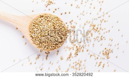 Food Swap. White Quinoa In Round Wooden Spoon Close Up, Free Space
