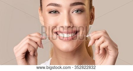 Teeth Flossing. Smiling Woman Using Tooth Floss Cleaning And Caring For Perfect White Teeth Posing O