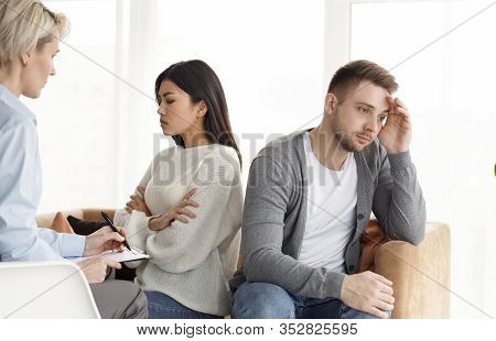 Family Counseling. Indifferent Spouses Having Conflict Sitting Back-to-back Not Talking With One Ano