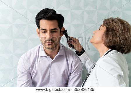 Mid Adult Latin Man Visiting Family Doctor For Checkup