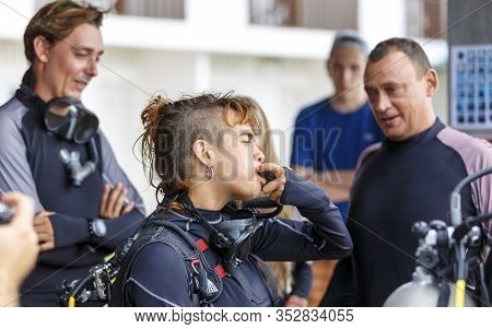 Team Of Divers Is Preparing Equipment. The Instructor Conducts Training Before Diving. Group Of Youn