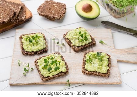 Food Swap. Ingredients For Sandwiches And Ready Vegetarian Snacks With Avocado Spread And Microgreen