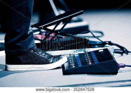 Guitar Player In Sneakers Stomp Overdrive Pedal, Studio