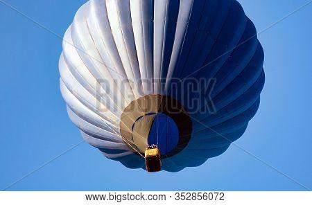 Dark Blue Balloon In The Sky. Aerostat. People In The Basket. Fun. Summer Entertainment. Romantic Ad