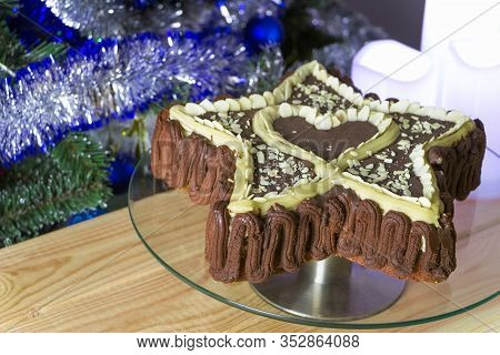 Freshly Baked Star-shaped Cake With A Heart Inside, Decorated With Natural Chocolate And Almond Flak
