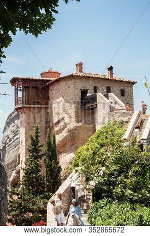 Meteora, Greece - June 12, 2009: Tourists Visit The Convent Of Rousanou (st. Barbara)