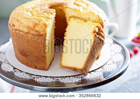 Pound Cake Or Angel Food Cake Sliced On A Cake Stand