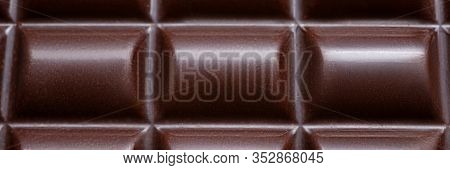 Close-up Of Yummy Dark Chocolate Bar Melt In Peculiar Form Of Round Shape Tile Made Of Bitter Cocoa