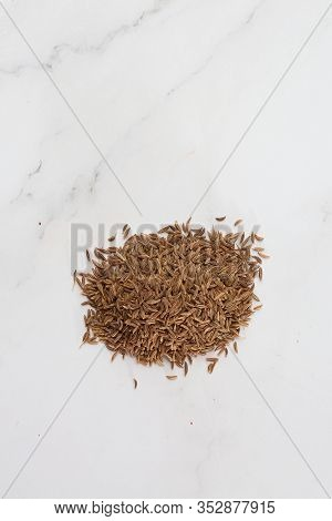 Pile Of Cumin Seeds Captured From Above Isolated On White. Seeds Of Caraway, Also Known As Meridian