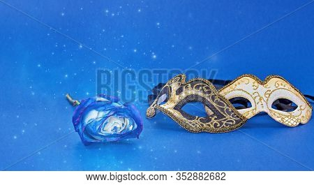 Mardi Gras Carnivale Masquerade Mask On Blue Background With Copy Space. Carnival Mardi Gras Day Par