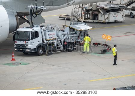 Zurich, Switzerland - July 19, 2018: Airport employees refuel passenger aircraft