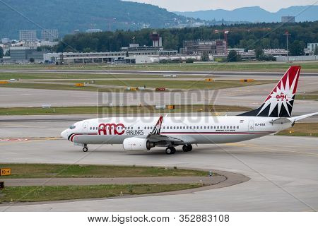 Zurich, Switzerland - July 19, 2018: AMC charter airlines airplanes preparing for take-off at day time in international airport