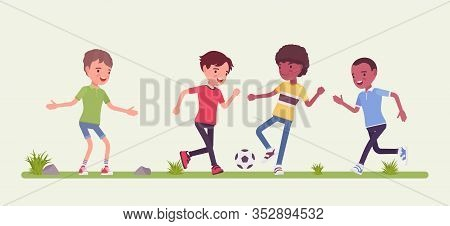 Street Football Young Players. Amateur Junior Sport Team Playing Soccer Outdoors On A Green Grass Ya