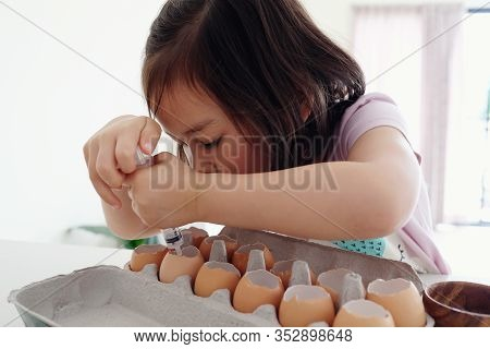 Mixed Asian Girl Planting Seeds Into Eggshells, Eco Gardening,  Homeschool Montessori Education, Reu