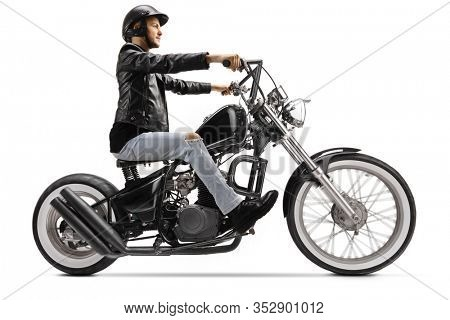 Biker riding a custom chopper motorbike isolated on white background