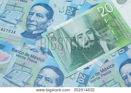 A Close Up Of A Green And White, Twenty Serbian Dinar Bank Note On A Background Of Mexican Twenty Pe